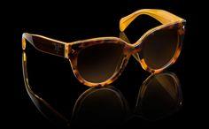 Occhiali da sole Prada Fashion color corteccia dalla collezione primavera estate 2013.