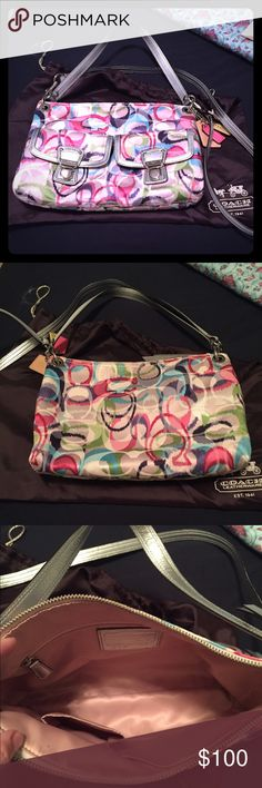 Colorful Coach purse Gently used Coach purse. Two outside clip pockets. One inside zip pocket and two open slots. Cross body strap is removable. Coach Bags Crossbody Bags