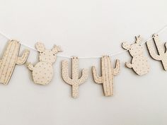 Laser Cut Wood Cactus Garland - Cactus Baby Shower - Nursery Sign - Cacti Party - Cactus Banner - Birthday Decor - Cactus Party by StudioNoelDesigns on Etsy Could maybe make a cute banner like this?
