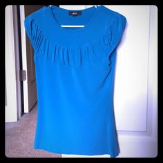 SALE! Blue top from BCX Cute blue top that is perfect for work or with a pair of jeans. Size medium. 92% polyester 8% spandex. BCX Tops