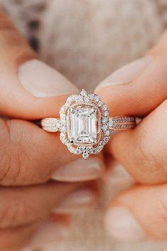 Emerald cut diamond with unique halo. Rose gold. #RoseGoldJewellery