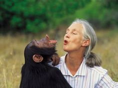 Jane Goodall singing with a chimp