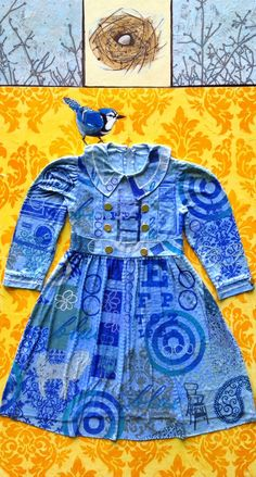 "Kathrine Allen-Coleman ~ ""It's ok to be blue too."" (2014) Mixed media; Layers of linoleum block prints, a nest made of dress pattern tissue, vintage dress and bits of 18k gold leaf 24 x 44 in. via her blog: Dress Paintings"