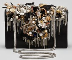 This Saint Laurent Betty Bag looks like the bottom of my Mom's craft drawer in the 90s. Oh, and it's $7,500! Crazy!