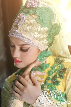 Wedding Gown and Hijab,Makeup by Raya Wedding  Photo by Ernest