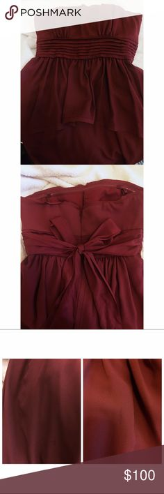 Wine Red BCBG Gown Super flattering and elegant BCBG Gown! Worn once for a wedding. Color is an absolutely gorgeous wine red. This dress is in wonderful shape! I scoured it for imperfections and only found a few faint marks on the skirt and a tiny stain hidden in the peplum! See pic three (first photo is markings on skirt, these are long and thin, but VERY faint- probably from an iron; second photo is stain on peplum, about half an inch in size) BCBGMaxAzria Dresses