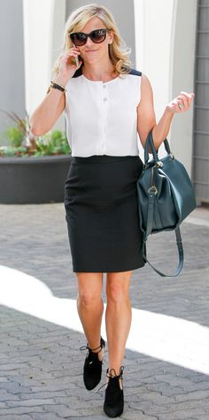 Reese Witherspoon upped her sophistication level with a black-and-white sleeveless top that she tucked into a black tailored pencil skirt, complete with a dark jade carryall and ankle-tie booties. #InStyle