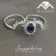White gold sapphire engagement ring with fitted matching diamond eternity bands.