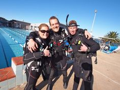 Instructor team waiting to get into the water for their skill practice. Smiles all round.
