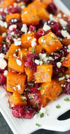 Honey Roasted Butternut Squash with Cranberries and Feta This sweet and savory side dish is perfect for the holidays and loaded with Fall flavor! - Honey Roasted Butternut Squash with Cranberries and Feta :: so easy + delicious… Vegetable Dishes, Vegetable Recipes, Veggie Recipes Sides, Roasted Butternut Squash, Recipes With Butternut Squash, Butternut Squash Side Dish, Acorn Squash, Butternut Squash Thanksgiving Recipe, Vegetarian Meals