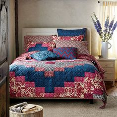 The Tamara patchwork quilt draws from an eclectic mix of global influences, from traditional ikats to floral paisleys and Indian woodblock prints.