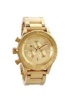 The Nixon All Gold Chronograph watch is an elegant analog timepiece with superior functionality. Add class to your looks with the all gold stainless steel rotating bezel and case with a gold locking band with Japanese quartz movement and a 20 Hugo Boss Homme, Festina, Style Classique, Bling, Bracelet Cuir, Stainless Steel Watch, Swagg, Look Fashion, Fashion Spring