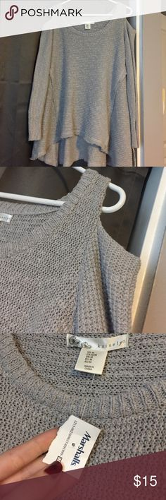 "BRAND NEW grey sweater. Still has tags!! Grey sweater with ""cold shoulder"" cutouts. Tags still attached. From Marshalls. Size M! Tops Sweatshirts & Hoodies"