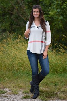3/4 Sleeve Cream Top. True to size, but has a looser fit. **Print/Stripes will vary in location on top. Material: 92% Polyester 8% Spandex Model is 5'10'' a size 9 wearing a small. Product Sizing Char
