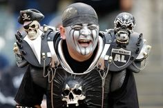 An Oakland Raiders fan smiles during a game between the Oakland Raiders and the Dallas Cowboys in Oakland, Calif. (Ben Margot/AP)