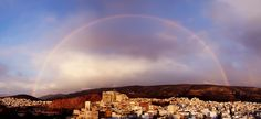 Rainbow above Imitos Mountain taken at Ilioupoli, Athens.  This photo is actually eight separate vertical shots combined with Autostitch.  Photo credit: Chris Kotsiopoulos.