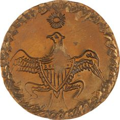 George Washington Inaugural brass clothing button, with an American eagle and chevron punch marks.