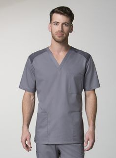 Our EON mens scrub top has all the necessities for any guy in the medical industry. Made from extra breathable fabrics, these medical scrubs will keep you cool and dry all day long. A stylish fit and multiple pockets make these scrubs perfect for doctors and nurses alike