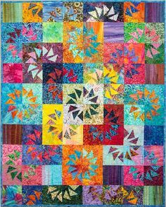 Ripples, Quiltworx.com, from the Geese Migrations book, designed by Certified Shop, Cozy Quilts! Uses Fiji Batiks Layer Cakes (2 packages) by Moda Fabrics United Notions!
