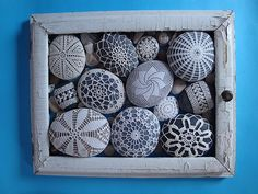 crochet lace over stones in a frame
