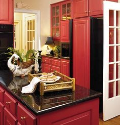 Many of us love red tones because they impart a festive quality. Red kitchen cabinetry really stands out against cream-colored walls and white trim. When using a bold color, you don't want the room to feel closed in. To add some lightness to a tight corne Country Kitchen, New Kitchen, Kitchen Decor, Kitchen Ideas, Black Kitchens, Cool Kitchens, Kitchen Black, Layout Design, Design Ideas