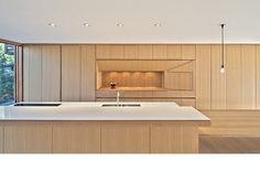 "Blantyre House - Williamson Chong; Designed by Williamson Chong Architects, fabricated by Khang Le, KGA Custom Cabinetry ­ 3⁄4"" thick select grade rift cut white oak veneered plywood panels with either 1/8"" solid edging or 1­1/2"" tapered solid edging. Double boiled linseed oil finish. Countertop: Caesarstone Blizzard (2141). Faucet: Vola 590V"