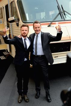 A Toast. Aaron Paul and Bryan Cranston celebrate at the Breaking Bad series finale premiere.