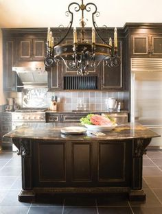 Black cabinets and chandelier