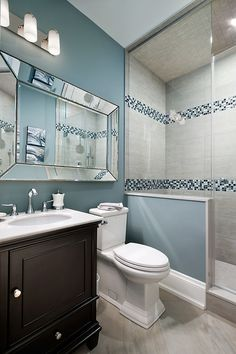 Bathroom Ideas. Benjamin Moore Buxom Blue. I am loving the oversized mirror that run from the vanity, occupiying mostly of the wall.