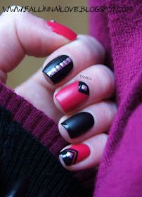 Pink/Black nails with stud detail.