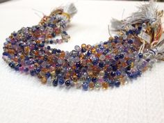 Multicolor Sapphire Briolette Beads, gorgeous color and cut. Blues, Pinks and Yellows all mixed together!