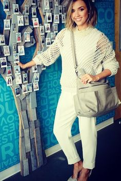 Jessica Alba wearing the Honest Company Caryall Satchel in Grey