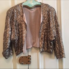 Rose Gold Sequin Shrug Rose gold sequins. Fully lined. Perfect topper for any outfit. Great condition! Anthropologie Jackets & Coats