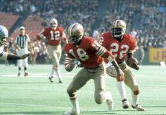 Dec 23, 1972; San Francisco, CA, USA: FILE PHOTO; San Francisco 49ers running back Vic Washington (22) carries the ball behind Gene Washington