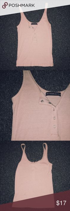 ❦brandy melville baby pink tank cropped baby pink tank from brandy melville! its pretty tight fitting but super cute. in perfect condition. Brandy Melville Tops Tank Tops