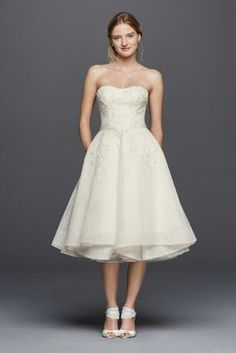 A tea-length dress with a flirty pleated skirt is the perfect match for daytime nuptials. Bonded lace with beaded lace appliques make this wedding dress shine. This short dress is also designed with p