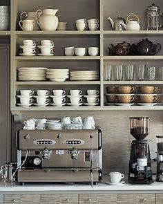 Open shelving in a home coffee bar. This would help really make the coffee bar feel like a distinctly different area of the kitchen. Could also work well in a butlers pantry / coffee bar area. Cozy Coffee Shop, Coffee Bar Home, Home Coffee Stations, Coffee Shop Design, Coffee Corner, Coffee Bars, Coffee Maker, Coffee Wine, Coffee Creamer