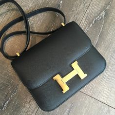 #Hermes 18cm Constance in black Epsom leather with gold hardware 《 As per October 2015 Constance Elan: Epsom; $8677 USD, £5110 GBP --Hermes Constance 18: Alligator; $25200 USD, Epsom; $7250 USD excl. tax, Swift; $7650 USD excl. tax -- Hermes Constance 24: Epsom; $9050 USD (+ tax), 8250 CHF, $10885 AUD, Sombrero; £6150 GBP, Swift; £6100 GBP》
