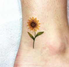 Floral tattoo designs have always been desirable since the beginning of tattoo a. Floral tattoo designs have always been desirable since the beginning of tattoo art. Roses, lilies, orchids are all b Sunflower Tattoo Meaning, Sunflower Tattoo Simple, Sunflower Tattoo Sleeve, Sunflower Tattoo Shoulder, Sunflower Tattoos, Sunflower Tattoo Design, Watercolor Sunflower Tattoo, Bild Tattoos, Leg Tattoos