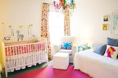 Very cute, modern, British nursery. I especially love the animals and trees on the wall and the Queen throw pillow