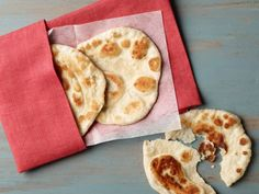 Pizza Dough Naan : You've mastered a mean curry, now try your hand at Indian-style bread. Simply shape dough into flat rounds and fry them up in clarified butter (called ghee) or oil, turning once, until puffy and golden.
