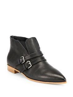 A sleek point toe offers modern sophistication to a double-strapped ankle boot in buttery Italian leather.