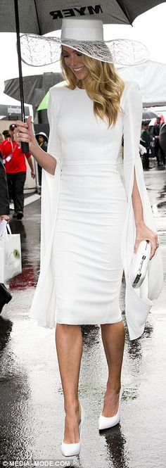Hot to trot: The former Miss Universe didn't let the rain stop her from looking incredible...