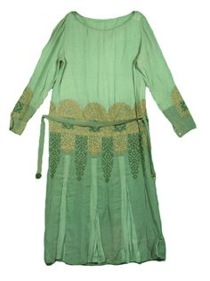Dress (woman's) c. 1927 - 1928 Plain weave; Embroidered; Embroidered, machine; Fabricated (metal); Enamel; Crochet; Applique Silk crepe de Chine; Metallic thread; Metal snaps; Cloisonne clasp