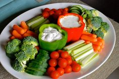 Homemade Veggie Platter Ranch dip in one pepper Cucumber dill dip in the other