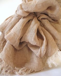Beige Unisex Pure Linen Scarf  by LinenWorld.    ✔ Linen fibre goes damp and dry very soon, that is why the fabric warms during cold night and cools the body during hot midday.    ✔ Linen fabric makes the best microclimate for the skin of all fabrics, i.e. it is permeable to air, absorbs dampness and sweat very quickly.    ✔ Linen fabric is ecological. It is absolutely without surplus product and does not make any harm to nature and ecology. $23.90