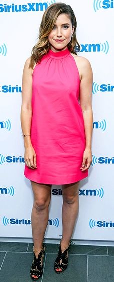 Sophia Bush wears a bright pink halter-neck dress by Max Mara and Sophia Webster shoes at a Sirius XM event