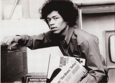 Jimi Hendrix cueing up some blues LPs.
