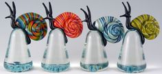 paperweights! Gorgeous snails by Eric Bailey. I would very much like all of them!  http://www.ebglassworks.net/glass.html