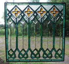 I love the idea of hanging stained glass in the garden